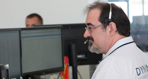 Dynamic Business Technologies' IT support technician on headset helping a caller